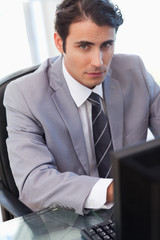 Portrait of a serious businessman working with a computer