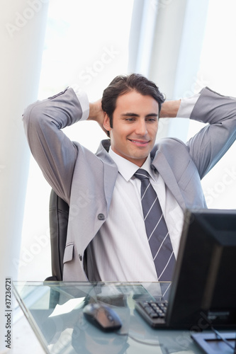 Portrait of a relaxed businessman working with a computer
