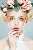 Seductive blonde in colored wreath - 37240918