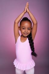 Cute little African American girl dancing