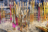 a group of incense sticks at a buddhism temple china poster