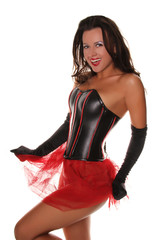 Sexy Happy Girl in Leather Corset and Red Mesh Skirt Flirting