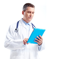 Smiling doctor with tablet computer.