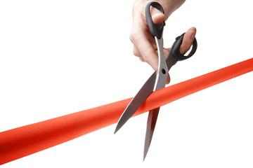 cutting a red ribbon