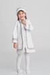 Laughing little girl in a Snow-maiden fancy dress