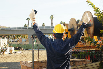 construction man rising his hands