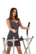 woman gray dress walking machine