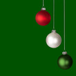 White, Red and Green Christmas Ornaments Isolated On Green