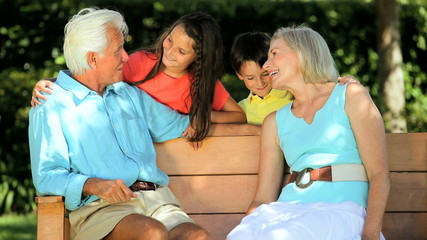 Caucasian Grandparents Being Visited by Grandchildren