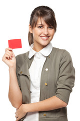 Close-up of young business woman holding credit card