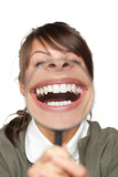 Funny image of female with magnifying glass showing teeth - 37276925