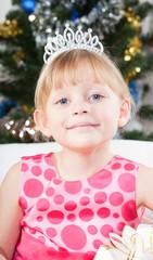 little girl at a Christmas fir-tree
