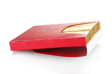 single chewing gum wrapped in standard red packaging isolated
