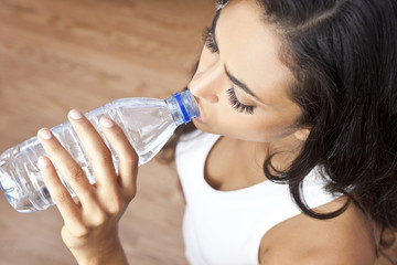 Latina Hispanic Woman Girl Drinking Water Bottle at Gym