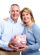 Senior couple with a piggy bank.