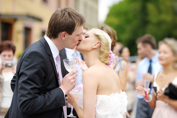 Beautiful bride and groom kissing
