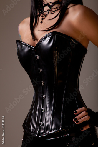 Slim sexy woman with hourglass figure in black leather corset