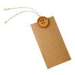 Blank tag tied with string and wood button.