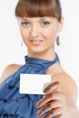 Young beautiful girl shows a business card