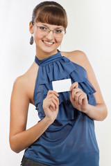 Young beautiful Smiling girl shows a business card