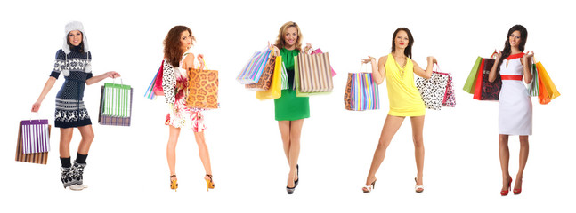 Young beautiful women holding shopping bags