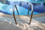Swimming pool ladder handrail. poster