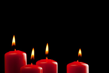 four red candles over black