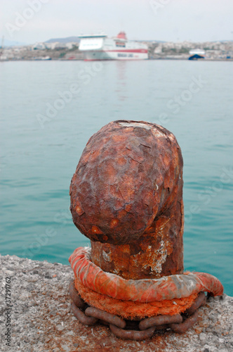 A rusty bollard. Abstract travel background.
