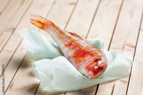 Fresh red mullet on wooden table