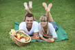 Couple enjoying picnic in park - 37294934