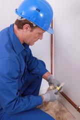 plumber working indoors