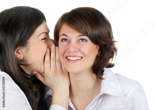 Two young happy women talk