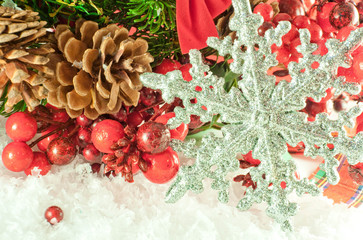 Christmas branch of berries with a silver  snowflake