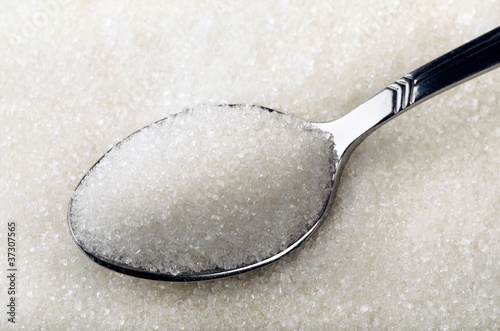 Tea spoon of white granulated sugar
