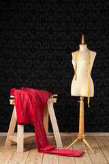 tailor mannequin with red piece of cloth