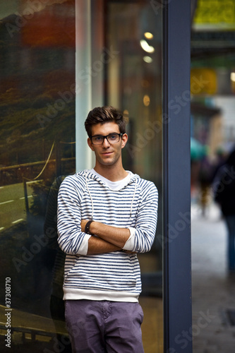 Cool young man in front of urban setting