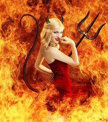 Sexy young woman as devil in fire