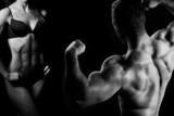 Kobieta i meżczyzna w siłowni - 37316553