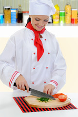 Chef cuts the tomato