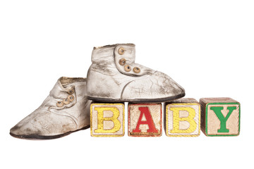 Vintage baby boots and blocks isolated on white