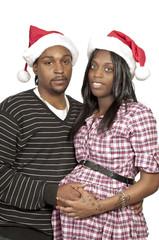 Black Couple wearing Christmas Santa Hats