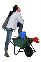 Man with wheelbarrow and spade