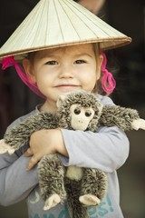 Baby girl in Vietnam's hat