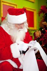 Santa reading a Christmas letter
