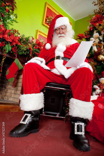 Santa sleeping with a letter