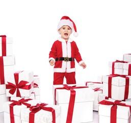 Displeased baby boy in Santa Claus costume