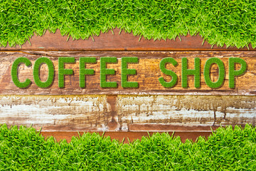green grass coffee shop word on wood background