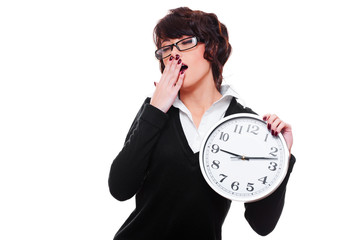 businesswoman holding clock and yawning