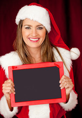 Mrs Claus with a blackboard