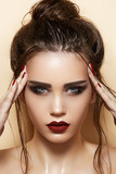 Model with sexy lips makeup, strong eyebrows, wet bun hairstyle poster